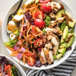 Bowl of healthy Cobb salad with balsamic grilled chicken.