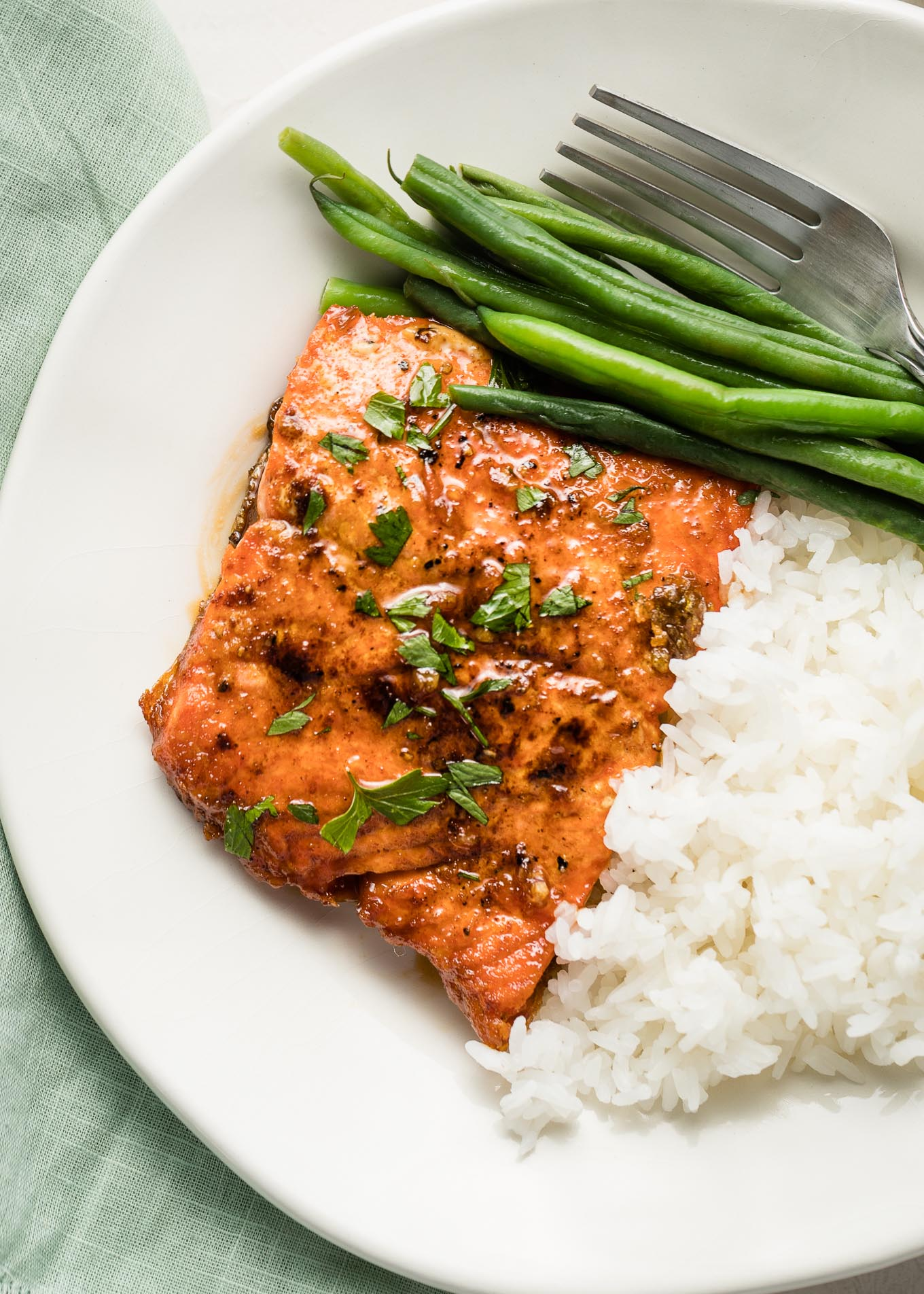 Honey garlic salmon plated with rice and green beans.